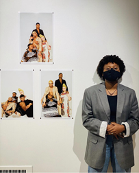 Makayla Camille stands beside her photo series Blaque 365 during the 2020 UMKC Student Art Exhibition